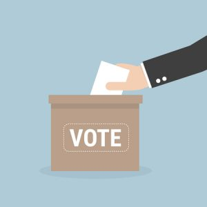 voting concept in flat style - hand putting voting paper in the ballot box